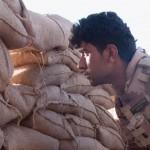 behind-sandbags